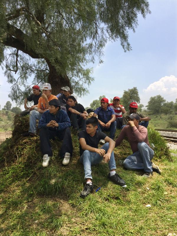 Migrants from Central America rest alongside the railroad tracks outside Huehuetoca. The group is waiting to jump aboard a freight train headed toward the U.S. border. Of the 15, there are three minors, all traveling alone.