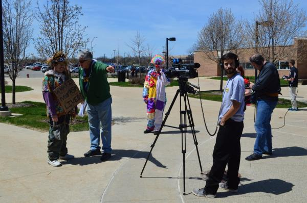 Director John Martin works with autistic adults on set. (Rebecca Wilbanks)
