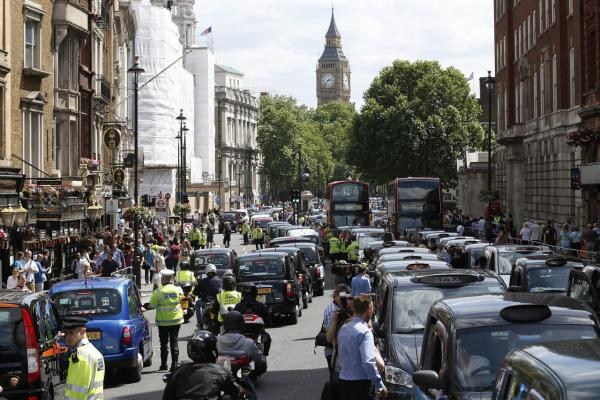 Roads are snarled on June 11 in London as taxi drivers stop their black cabs, blocking the street to protest over new technology they say endangers passengers. The strike action by taxi drivers hit many European cities, Wednesday, sparked by fears about the growing upheaval in the travel and transport industry, largely due to digital technologies like Uber. (Sang Tan/AP Photo)