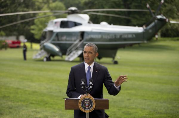 President Barack Obama talks about his administration's response to a growing insurgency foothold in Iraq, Friday, June 13, 2014, on the South Lawn of the White House in Washington, prior to boarding the Marine One Helicopter for Andrews Air Force Base, Md., then onto North Dakota and California. (Pablo Martinez Monsivais/AP)