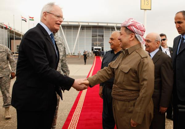 U.S. Ambassador to Iraq James Jeffrey (L) shakes hands with Kurdish Regional Government President Massoud Barzani  at the airport in Irbil, Iraq in April 2011. (Chip Somodevilla/Getty Images)