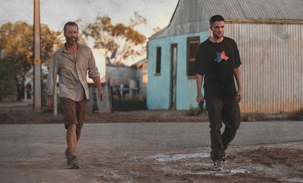 """The Rover"" is an Australian dystopian crime drama film starring Guy Pearce and Robert Pattinson. (A24)"