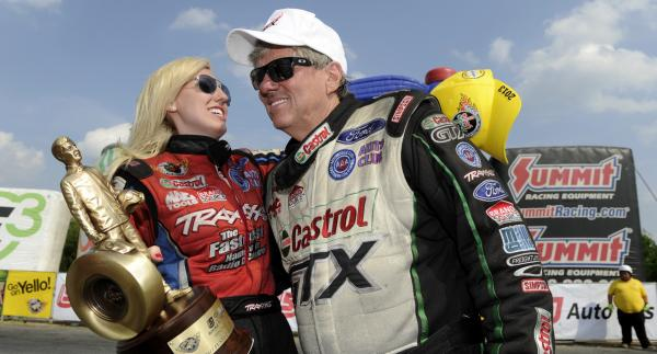 Courtney Force celebrates with her dad after a 2013 race in Epping, N.H.