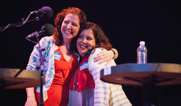 Contestants Micaela Blei and Krissa Corbett Cavouras share a hug after a thrilling final round game.