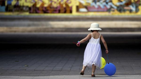 A child plays in a Beijing park. Health threats caused by pollution have become a major concern in China.