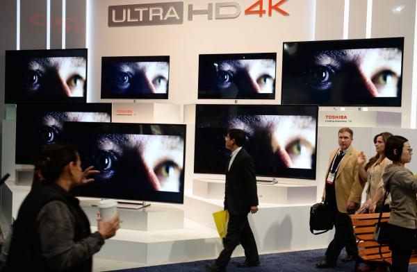 Attendees walk past the Toshiba Ultra HD 4K TV display at the 2014 International CES in Las Vegas, Nevada, January 8, 2014. (Robyn Beck/AFP/Getty Images)