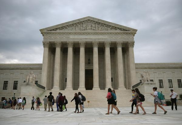 People arrive to attend the final session of the term at the U.S. Supreme Court on June 30, 2014 in Washington, DC. (Photo by Mark Wilson/Getty Images)