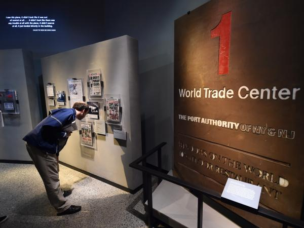 A One World Trade Center sign and exhibits are viewed during a press preview of the National September 11 Memorial and Museum in New York City.