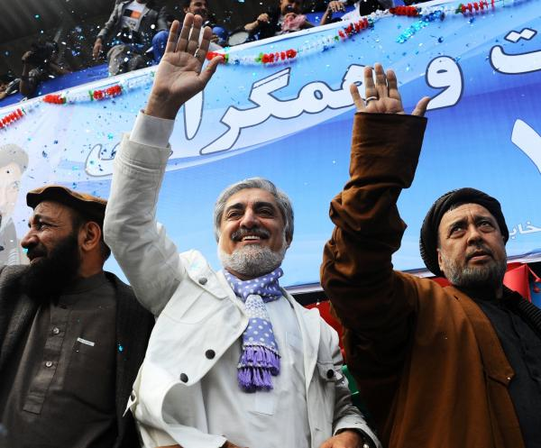 Afghan presidential candidate Abdullah Abdullah (center) and his vice presidential candidates Mohammed Mohaqiq (right) and Mohammad Khan (left) wave to their supporters at a rally in the northwestern city of Herat in April.