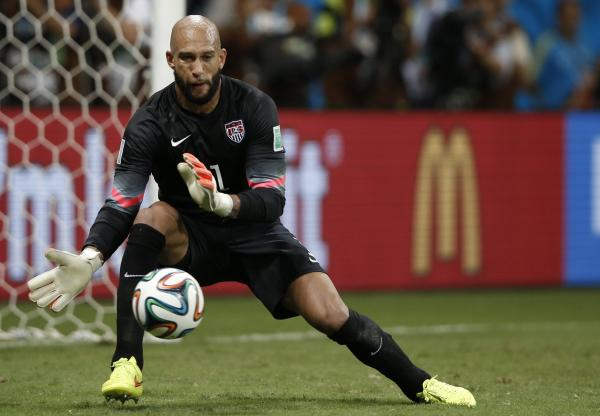 U.S. goalkeeper Tim Howard makes a save during extra time in the World Cup Round of 16 match with Belgium. Howard's record 16-save performance set off admiration and several Internet memes.