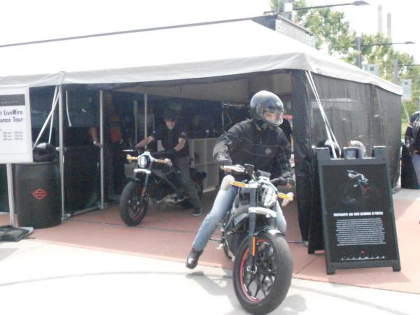 """Riders test out Harley Davidson's """"Livewire,"""" which  weighs only about 450 pounds, compared to the 700 to 800 pounds for a more typical Harley (Latoya Dennis)"""