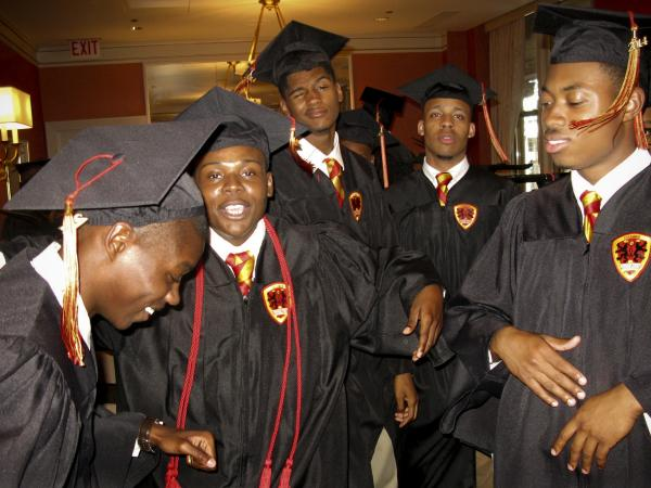In one of the waiting rooms of the Chicago Civic Opera House, Urban Prep graduates dance and let off some steam before the school's commencement ceremony begins.