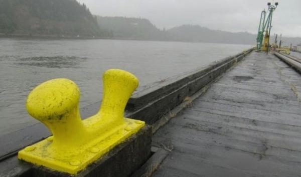 This dock at the Port of St. Helens near Clatskanie, Oregon, is a component of a crude oil shipping project on the Columbia River. A lawsuit filed by environmental groups claims the project's operator lacks proper air pollution permits.