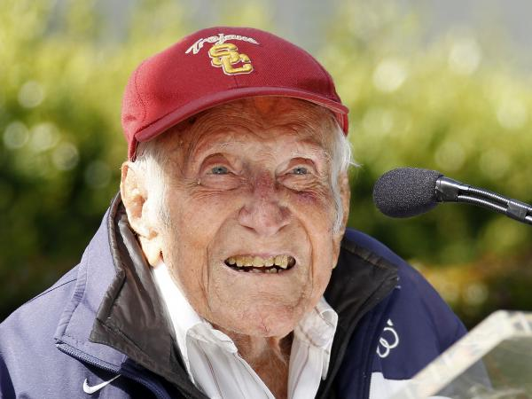 Louis Zamperini at a news conference in May in Pasadena, Calif. Zamperini, a onetime Olympic runner who in World War II survived a brutal internment in a Japanese POW camp, has died at 97.