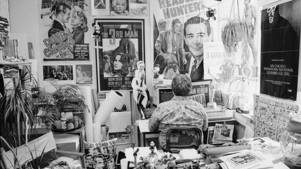 Roger Ebert was surrounded by movie memorabilia in his office. The new documentary <em>Life Itself</em> captures how Ebert lived life and faced death.