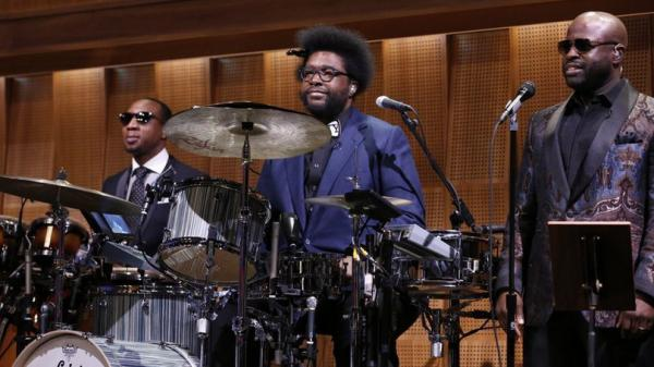 "Ahmir ""Questlove"" Thompson (center) appears with The Roots members Frank Knuckles (left) and Tariq ""Black Thought"" Trotter during the first episode of <em>The Tonight Show Starring Jimmy Fallon</em>."