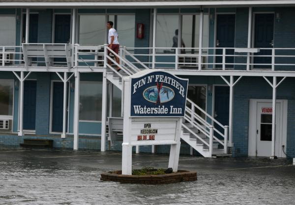 A man looks out from a hotel that was flooded by Hurricane Arthur, July 4, 2014 in Nags Head, North Carolina. Hurricane Arthur hit North Carolina's Outer Banks overnight and is now back out to sea, moving north. (Mark Wilson/Getty Images)