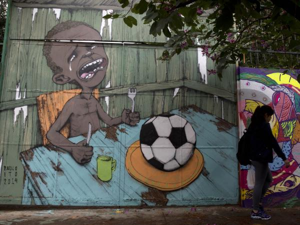 Paulo Ito's picture of a starving child left to dine on a soccer ball has been shared more than 50,000 times on Facebook.