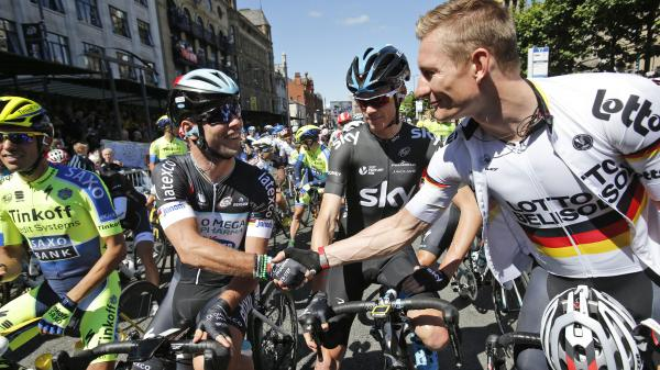 Sprinters Mark Cavendish of Britain (second left) and Germany's Andre Greipel, (right) shake hands as Britain's Christopher Froome (second right) and Spain's Alberto Contador (left) wait for the start of the first stage of the Tour de France on Saturday.