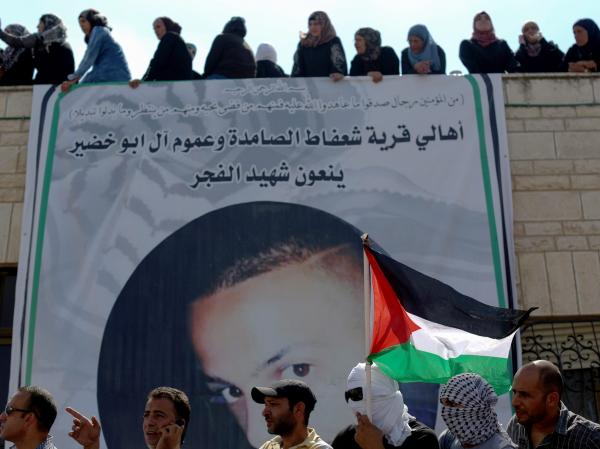 Palestinians attend the funeral of 16-year-old teen Muhammed Abu Khdair, at the East Jerusalem neighborhood of Shuafat, on Friday.