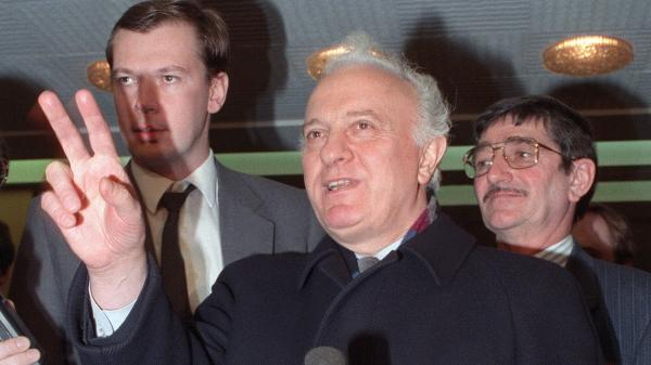 "Then-Soviet Foreign Minister Eduard Shevardnadze flashes a ""V"" sign in France in 1989, after attending the International Conference on Chemical Weapons. Shevardnadze died Monday at age 86."