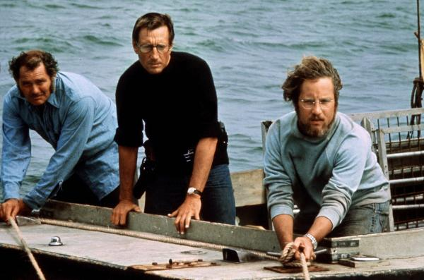 Robert Shaw (from left), Roy Scheider and Richard Dreyfuss play a shark hunter, a police chief and a marine biologist in 1975's <em>Jaws</em>.