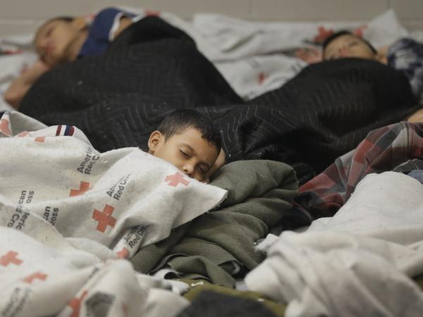 Detainees sleep in a holding cell at a U.S. Customs and Border Protection processing facility in Brownsville, Texas, on June 18. The White House on Tuesday sought $3.7 billion to deal with the immigration crisis at the border.