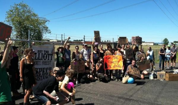 Protesters outside a Eugene biomass plant.