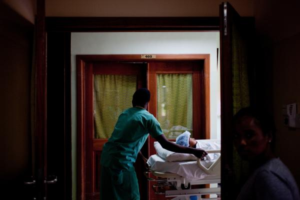Sisay is wheeled to the operating room at the Foundation for Orthopedics and Complex Spine hospital in Accra, Ghana, March 14. The hospital has room for four patients.