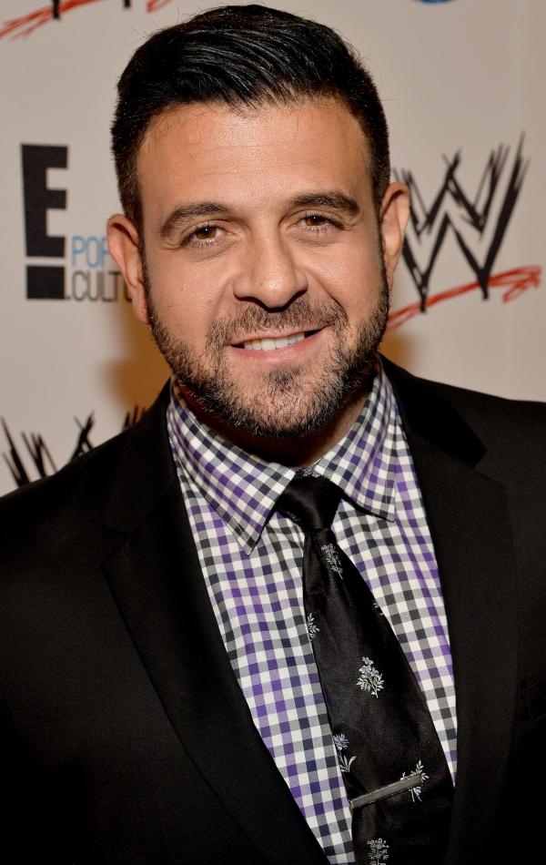 "The Travel Channel's Adam Richman, last year at a charity event in Los Angeles, had his new show indefinitely postponed after telling a critic via social media to ""grab a razor blade and draw a bath."""