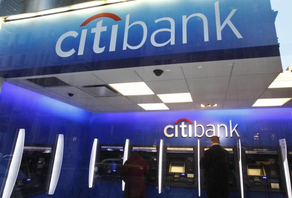 In this Jan. 6, 2012 photo, a Citibank customer makes a transaction at an ATM, in New York. (Mark Lennihan/AP)