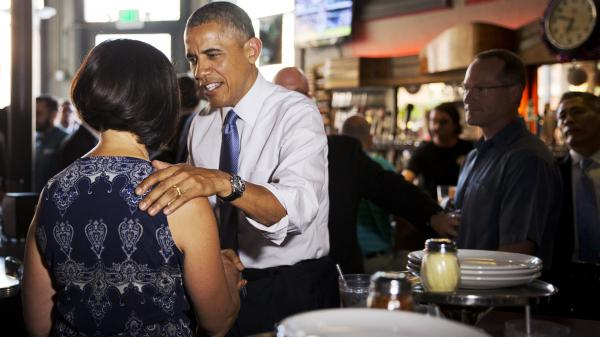 President Obama greets a woman at Wazee Supper Club in Denver on Tuesday. He was in Colorado this week speaking about the economy and raising money for congressional candidates.