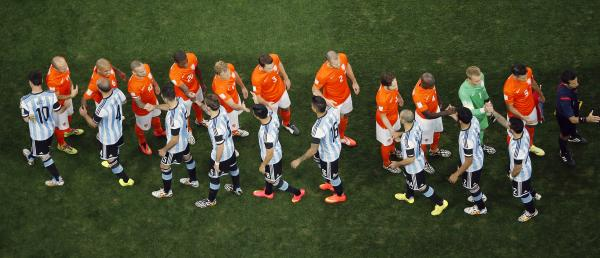 Argentine and Dutch players greet each other prior to their World Cup semifinal soccer match at the Itaquerao Stadium in Sao Paulo on Wednesday.