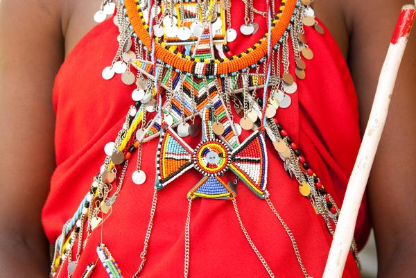 The Maasai wear vibrant colored <em>shukas</em>, or robes, adorned with elaborate beaded jewelry made by the women.