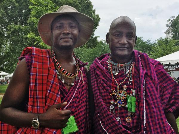 Maasai member Stephen Moiko (left) and junior elder Johnson Sipitiek pose for the camera at this summer's Smithsonian Folklife Festival.