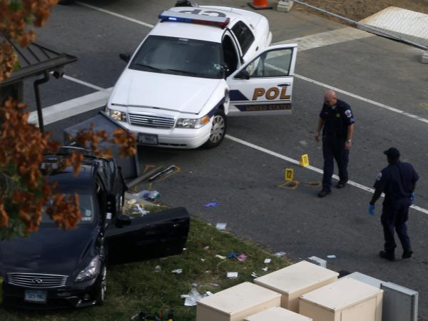 Capitol Hill police officers look at a car belonging to Miriam Carey after she was shot and killed on Oct. 3 following a high-speed car chase that started near the White House.