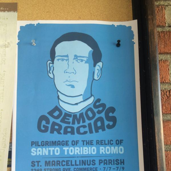 A poster advertises the pilgrimage of the relic of St. Toribio Romo.