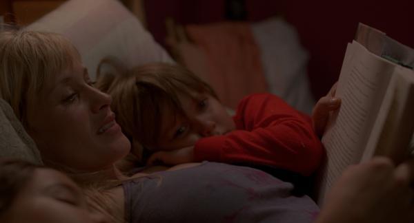 "In this still from ""Boyhood,"" Olivia (Arquette) reads a Harry Potter book to her children Mason (Coltrane) and Samantha (Lorelei Linklater) (Matt Lankes/IFC Films)."