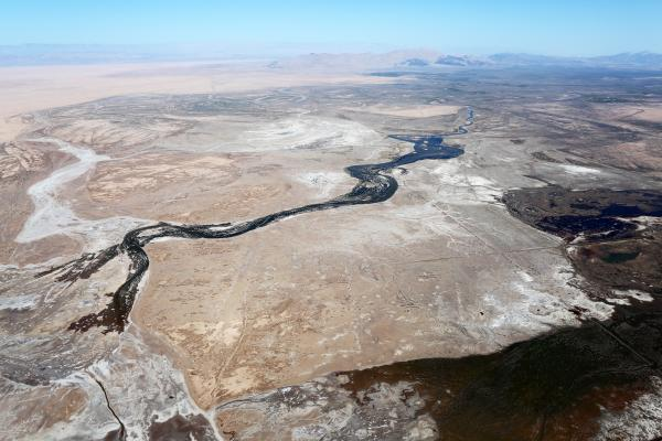 An aerial view of the lower portion of the Colorado River shows the leading edge of the pulse flow before it connects with the sea. You can see the part of the delta the water has yet to reach in white, in the lower left-hand corner.