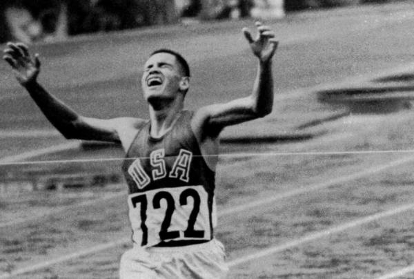 Billy Mills pulls off a stunning upset by winning the 10,000 meters Olympic race in Tokyo Oct. 14, 1964.  Mills set an Olympic record of 28:24:4, and was the only American ever to win the event. (AP Photo)