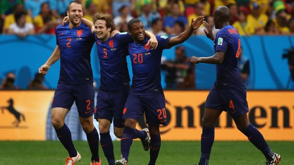 Daley Blind of the Netherlands (5) celebrates scoring his team's second goal with Ron Vlaar (2), Georginio Wijnaldum (20) and Bruno Martins Indi (right) during the 2014 FIFA World Cup Brazil Third Place Playoff match between Brazil on Saturday.