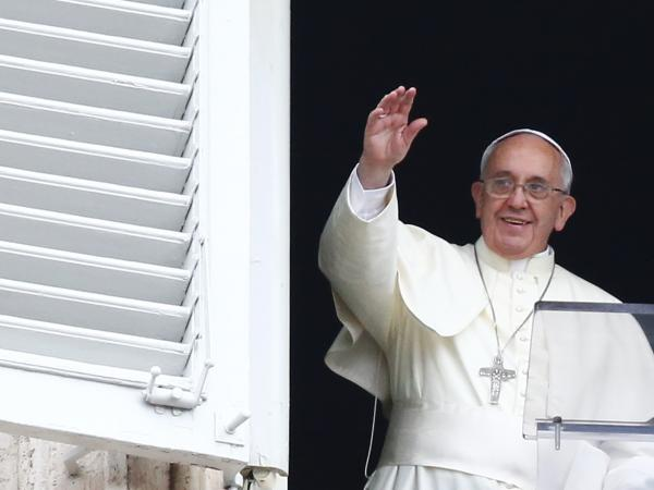 Pope Francis waves as he leads his Sunday Angelus prayer in Saint Peter's square at the Vatican on Sunday. Francis reportedly told an Italian newspaper that statistically, about 2 percent of Roman Catholic priests are pedophiles.