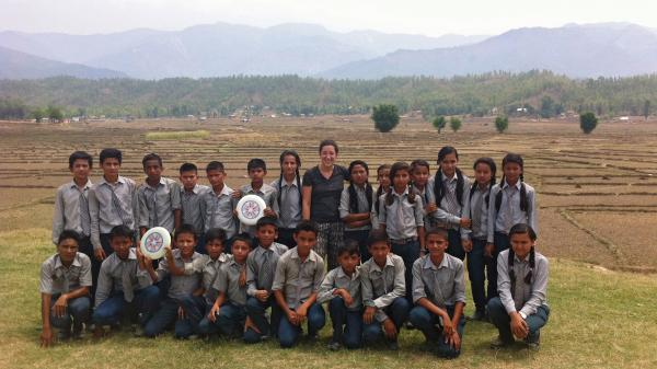 "Hannah Marqusee taught these Nepali 8th- and 9th-graders to play Ultimate Frisbee. ""Despite being terrible at throwing, they had a really good time,"" she reports. Their verdict: slightly more fun than soccer but not quite as fun as cricket. Bottom row, fourth from the right, is her host brother, Sachin."