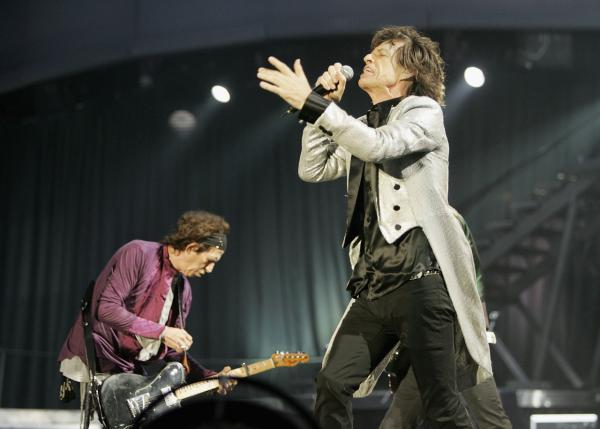 The Rolling Stones members Keith Richards (L) and Mick Jagger perform on stage at San Siro Stadium on July 11, 2006 in Milan, Italy.  (Getty Images)
