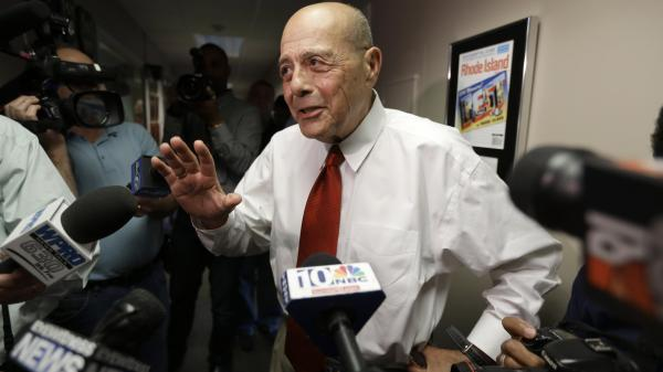 Former Providence Mayor Buddy Cianci speaks with reporters moments after announcing he will again run for mayor. Cianci, who made the announcement June 24 on WPRO-AM, was mayor for 21 years - longer than anyone else.