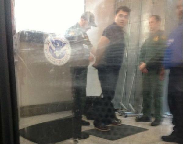 Jose Antonio Vargas in handcuffs at McAllen/Miller International Airport.