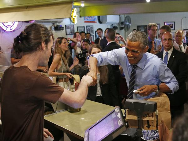 President Barack Obama fist bumps a Franklin Barbecue employee in Austin, Texas.