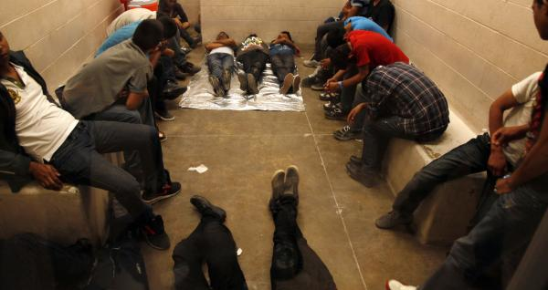 Immigrants who have been detained while crossing the border  are held inside the McAllen Border Patrol Station in McAllen, Texas, Tuesday July 15, 2014. (Rick Loomis/Los Angeles Times via AP)