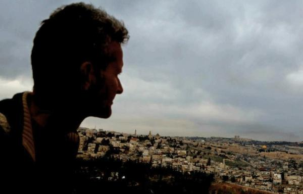 Paul Salopek, National Geographic fellow, looks out over Jerusalem during his seven-year journey by foot from Africa to South America.