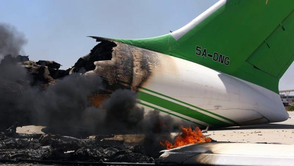 Flames and smoke billow from an airplane at the Tripoli international airport on Wednesday, the fourth day of fighting there